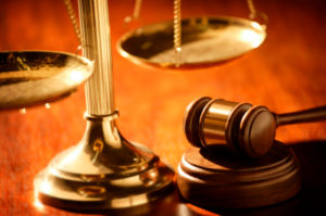 Old fashioned scales next to a judge's gavel